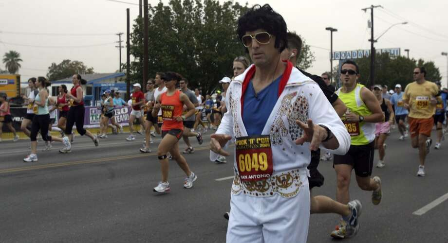 A runner dressed up as Elvis Presley runs down Broadway at the 2009 Rock 'n' Roll San Antonio Marathon and 1/2 Marathon. (SAN ANTONIO EXPRESS-NEWS)