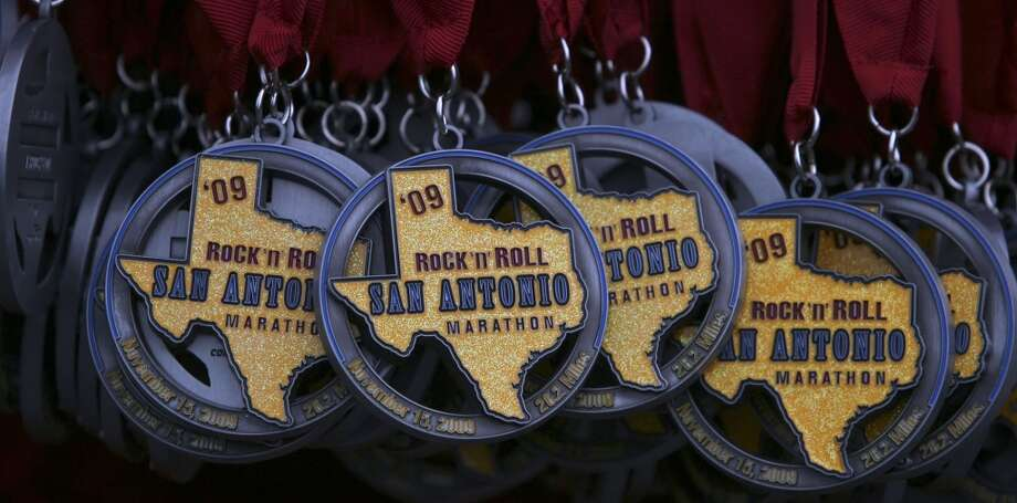 Medals of the 2009 Rock 'n' Roll San Antonio Marathon and 1/2 Marathon. (SAN ANTONIO EXPRESS-NEWS)