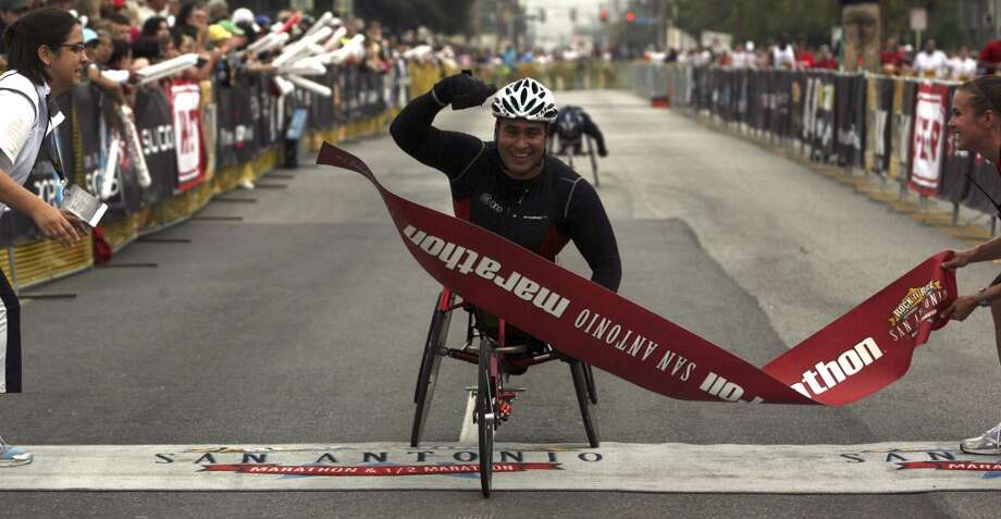 Saul Mendoza finished first in the wheelchair division of the Rock 'n' Roll San Antonio Marathon & 1/2 Marathon on Sunday Nov. 15, 2009. He finished with a time of 1:37:57. (SAN ANTONIO EXPRESS-NEWS)