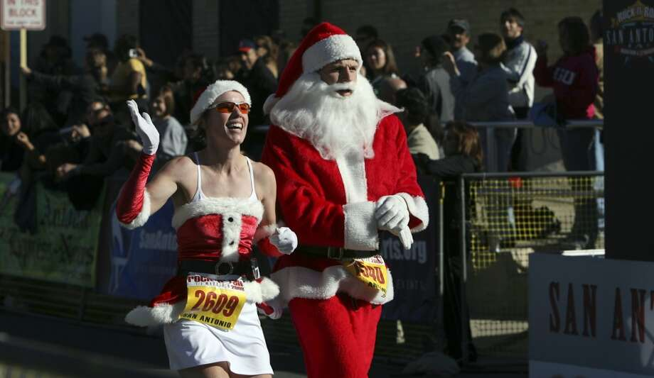 Marathon runners show their holiday spirit as they cross the finish line Sunday during the half marathon portion of the 2008 Rock 'n' Roll marathon and half marathon. (SAN ANTONIO EXPRESS-NEWS)