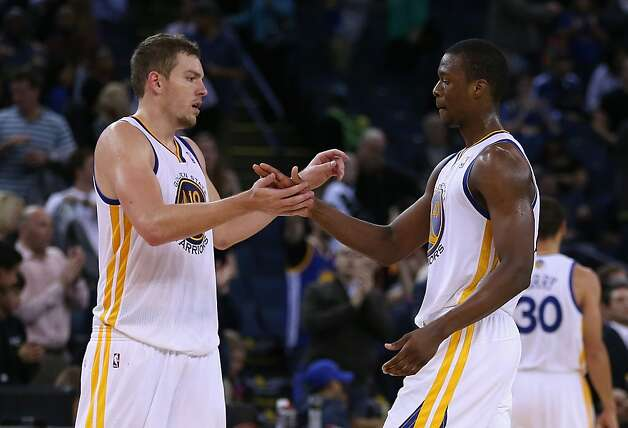 OAKLAND, CA - NOVEMBER 07: David Lee #10 and Harrison Barnes #40 of the Golden State Warriors celebrate after they beat the Cleveland Cavaliers at Oracle Arena on November 7, 2012 in Oakland, California.  NOTE TO USER: User expressly acknowledges and agrees that, by downloading and or using this photograph, User is consenting to the terms and conditions of the Getty Images License Agreement.  (Photo by Ezra Shaw/Getty Images) Photo: Ezra Shaw, Getty Images