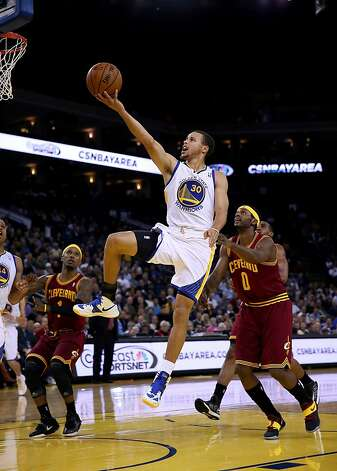 OAKLAND, CA - NOVEMBER 07: Stephen Curry #30 of the Golden State Warriors drives on C.J. Miles #0 of the Cleveland Cavaliers during their game at Oracle Arena on November 7, 2012 in Oakland, California.  NOTE TO USER: User expressly acknowledges and agrees that, by downloading and or using this photograph, User is consenting to the terms and conditions of the Getty Images License Agreement.  (Photo by Ezra Shaw/Getty Images) Photo: Ezra Shaw, Getty Images
