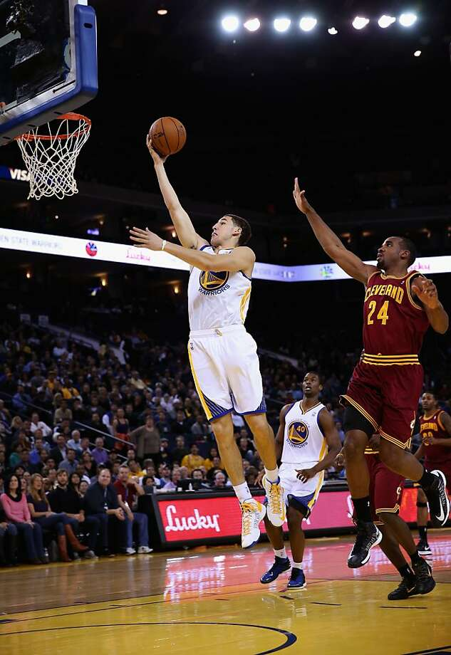 OAKLAND, CA - NOVEMBER 07: Klay Thompson #11 of the Golden State Warriors drives past Samardo Samuels #24 of the Cleveland Cavaliers at Oracle Arena on November 7, 2012 in Oakland, California.  NOTE TO USER: User expressly acknowledges and agrees that, by downloading and or using this photograph, User is consenting to the terms and conditions of the Getty Images License Agreement.  (Photo by Ezra Shaw/Getty Images) Photo: Ezra Shaw, Getty Images