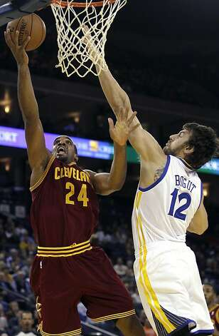Cleveland Cavaliers forward Samardo Samuels (24) shoots against Golden State Warriors center Andrew Bogut (12), from Australia, during the first quarter of an NBA basketball game in Oakland, Calif., Wednesday, Nov. 7, 2012. (AP Photo/Jeff Chiu) Photo: Jeff Chiu, Associated Press