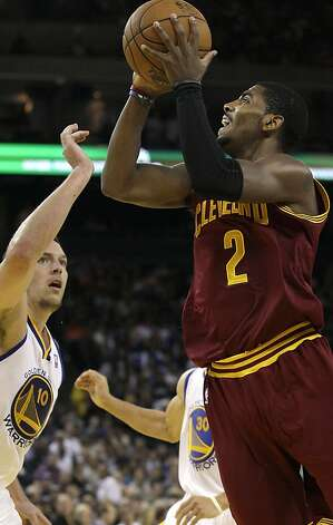 Cleveland Cavaliers guard Kyrie Irving (2) shoots against Golden State Warriors forward David Lee during the second quarter of an NBA basketball game in Oakland, Calif., Wednesday, Nov. 7, 2012. (AP Photo/Jeff Chiu) Photo: Jeff Chiu, Associated Press