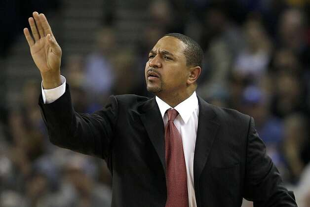 Golden State Warriors head coach Mark Jackson signals to his team during the second quarter of an NBA basketball game against the Cleveland Cavaliers in Oakland, Calif., Wednesday, Nov. 7, 2012. (AP Photo/Jeff Chiu) Photo: Jeff Chiu, Associated Press