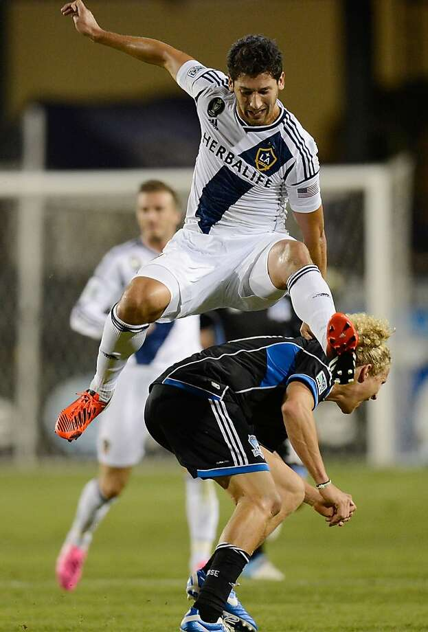 SANTA CLARA, CA - NOVEMBER 07:  Omar Gonzalez #4 of the Los Angeles Galaxy leaps for a header and comes down on the back of Steven Lenhart #24 of the San Jose Earthquakes during the first half of the Western Conference Semifinals at Buck Shaw Stadium on November 7, 2012 in Santa Clara, California.  (Photo by Thearon W. Henderson/Getty Images) Photo: Thearon W. Henderson, Getty Images