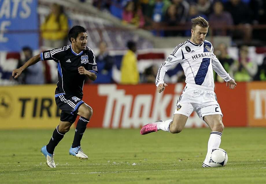 Los Angeles Galaxy's David Beckham, right, dribbles down field past San Jose Earthquakes's Rafael Baca during the first half of their MLS playoff soccer match in Santa Clara, Calif., Wednesday, Nov. 7, 2012. (AP Photo/Marcio Jose Sanchez) Photo: Marcio Jose Sanchez, Associated Press