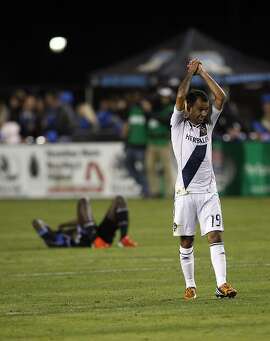 Juninho raises his hands in victory as the LA Galaxy defeated the San Jose Earthquakes in the 2012 MLS Cup Playoffs at Buck Shaw Stadium in Santa Clara, Calif., on Wednesday, November 7, 2012.