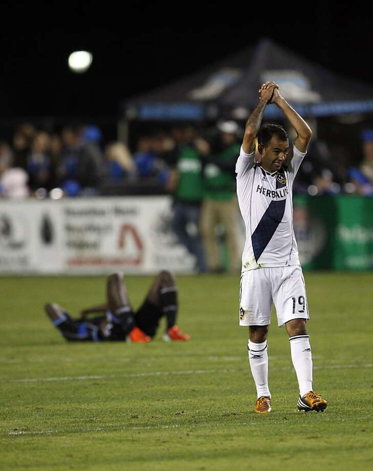 Juninho raises his hands in victory as the LA Galaxy defeated the San Jose Earthquakes in the 2012 MLS Cup Playoffs at Buck Shaw Stadium in Santa Clara, Calif., on Wednesday, November 7, 2012. Photo: Carlos Avila Gonzalez, The Chronicle