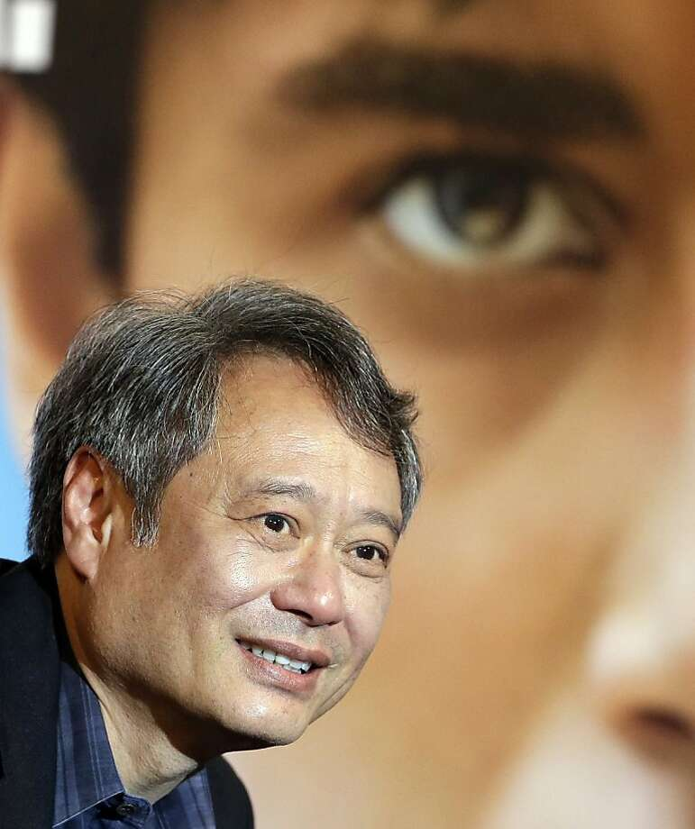 Taiwanese film director Ang Lee answers a reporter's question during a press conference for his new 3D movie Life of Pi in Seoul, South Korea, Monday, Nov. 5, 2012. (AP Photo/Lee Jin-man) Photo: Lee Jin-man, Associated Press
