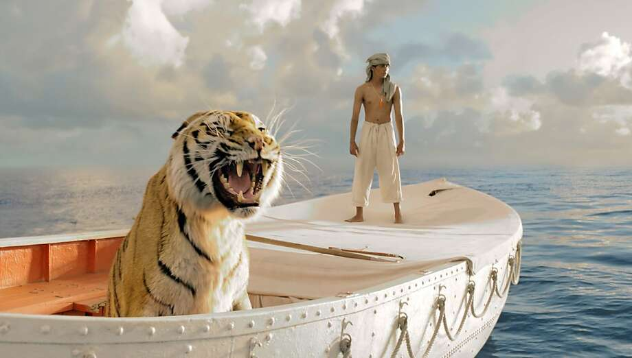 "This film image released by 20th Century Fox shows Suraj Sharma in a scene from ""Life of Pi."" Photo: Jake Netter, Associated Press"