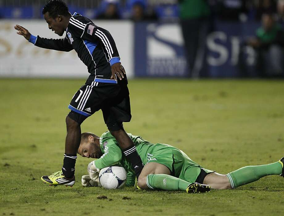 San Jose's John Busch dives for the ball in the final minutes at the feet of Marvin Chavez to stop an LA offensive move. The LA Galaxy defeated the San Jose Earthquakes in the 2012 MLS Cup Playoffs at Buck Shaw Stadium in Santa Clara, Calif., on Wednesday, November 7, 2012. Photo: Carlos Avila Gonzalez, The Chronicle