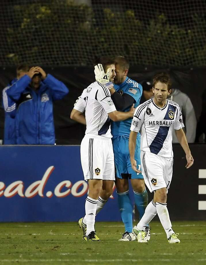 LA goalkeeper Josh Saunders hugs Tommy Meyer after a key defensive play kept the Earthquakes from scoring in the final minutes of the match. The LA Galaxy defeated the San Jose Earthquakes in the 2012 MLS Cup Playoffs at Buck Shaw Stadium in Santa Clara, Calif., on Wednesday, November 7, 2012. Photo: Carlos Avila Gonzalez, The Chronicle