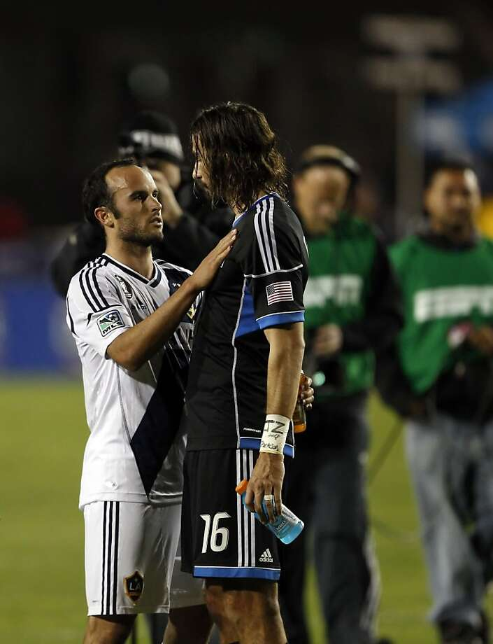 LA's Landon Donovan hugs San Jose's Alan Gordon after the match was over. The LA Galaxy defeated the San Jose Earthquakes in the 2012 MLS Cup Playoffs at Buck Shaw Stadium in Santa Clara, Calif., on Wednesday, November 7, 2012. Photo: Carlos Avila Gonzalez, The Chronicle
