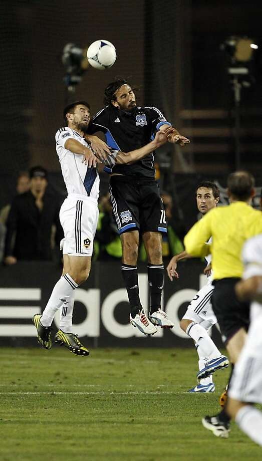 Tommy Meyer of the Galaxy, left, and Alan Gordon of the Quakes, go up for the ball in the second period. The LA Galaxy defeated the San Jose Earthquakes in the 2012 MLS Cup Playoffs at Buck Shaw Stadium in Santa Clara, Calif., on Wednesday, November 7, 2012. Photo: Carlos Avila Gonzalez, The Chronicle