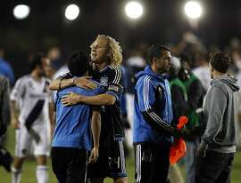 Steven Lenhart hugs Rafael Baca, facing away, after the match. The LA Galaxy defeated the San Jose Earthquakes in the 2012 MLS Cup Playoffs at Buck Shaw Stadium in Santa Clara, Calif., on Wednesday, November 7, 2012.