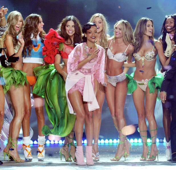 Singer Rihanna, center, celebrates during the finale.