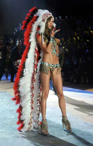 This Native-American headdress has some upset over  cultural insensitivity, but it's not the only outrageous outfit. Here are 10 crazy ones. Photo: Jamie McCarthy, Getty Images / 2012 Getty Images