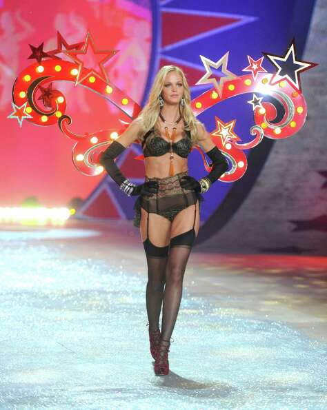 Victoria's Secret Angel Erin Heatherton walks the runway.