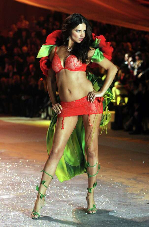 Victoria's Secret Angel Adriana Lima walks the runway. Photo: Jamie McCarthy, Getty Images / 2012 Getty Images