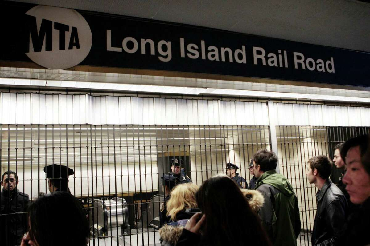 Patrons are directed away from the Long Island Railroad which is being closed off at Penn Station as service is suspended Wednesday, Nov. 7, 2012, in New York. One of the nation's largest commuter railroads is suspending service because of a nor'easter sweeping the same regions hit by Superstorm Sandy more than a week ago.