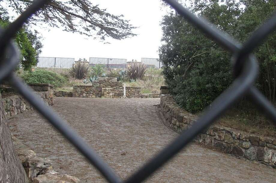 The Sloat entrance was closed more than a decade ago. Apparently the steep grade made it nearly impossible for ADA compliance. There are fences at Sloat Blvd. and also at the foot of the entrance where it meets the zoo playground. (Peter Hartlaub / The Chronicle)