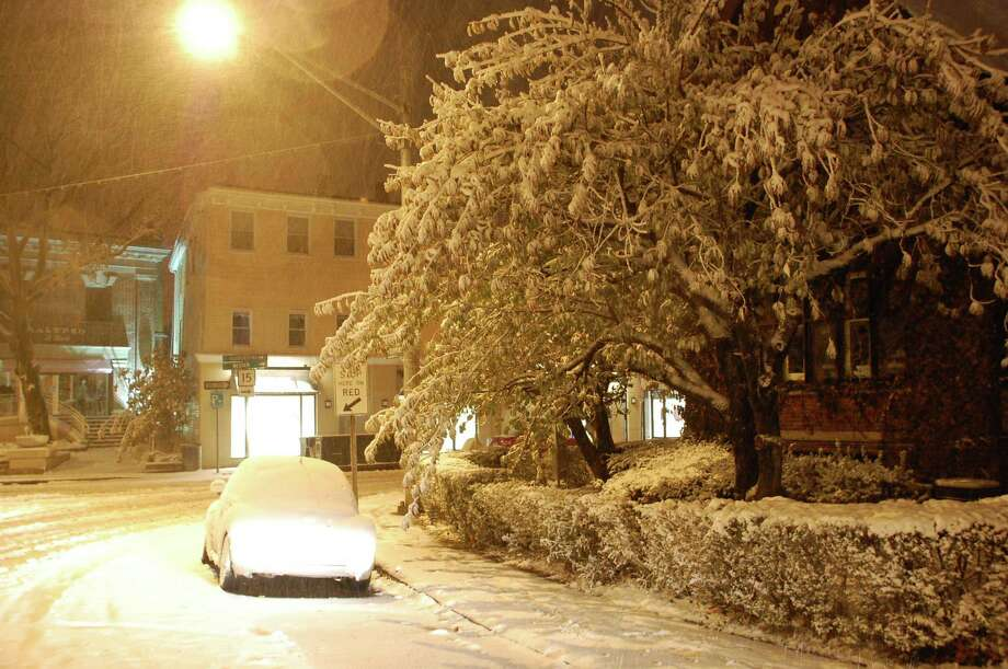 Several inches of snow and ice from a blustery nor-easter blanketed downtown Westport on Wednesday night. Westport CT 11/8/12 Photo: Jarret Liotta / Westport News contributed