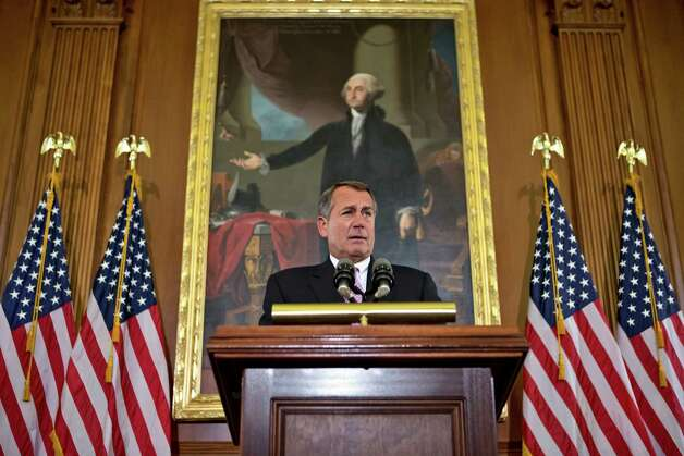 "In this Nov. 7, 2012, photo House Speaker John Boehner, R-Ohio, talks about the elections and the unfinished business of Congress at the Capitol in Washington. President Barack Obama is setting out to leverage his re-election into legislative success in an upcoming showdown with congressional Republicans over taxes, deficits and the impending ""fiscal cliff.""  Boehner says Republicans are willing to consider some form of higher tax revenue as part of the solution _ but only under what he calls ""the right conditions.""  (AP Photo/J. Scott Applewhite) Photo: J. Scott Applewhite"