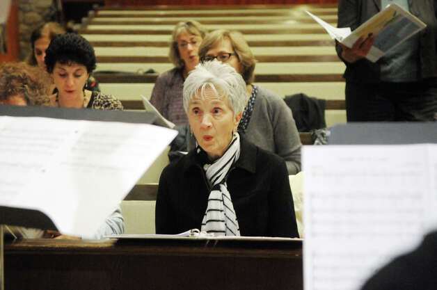 Jean Werdelin sings as the New World Chorus rehearses for a Thanksgiving multi-faith concert at Temple Beth El in Stamford, Conn., Oct. 25, 2012. The chorus formed on the 10th anniversary of 9/11, recently celebrating its first year. The group includes singers from a variety of faiths. Photo: Keelin Daly