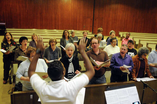 Jason L. Terry leads the New World Chorus as it rehearses for a Thanksgiving multi-faith concert at Temple Beth El in Stamford, Conn., Oct. 25, 2012. The chorus formed on the 10th anniversary of 9/11, recently celebrating its first year. The group includes singers from a variety of faiths. Photo: Keelin Daly
