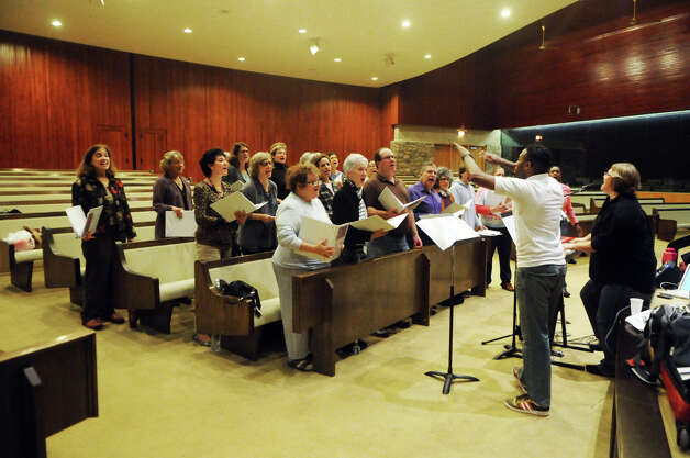 Beth Styles and Jason L. Terry lead the New World Chorus as it rehearses for a Thanksgiving multi-faith concert at Temple Beth El in Stamford, Conn., Oct. 25, 2012. The chorus formed on the 10th anniversary of 9/11, recently celebrating its first year. The group includes singers from a variety of faiths. Photo: Keelin Daly