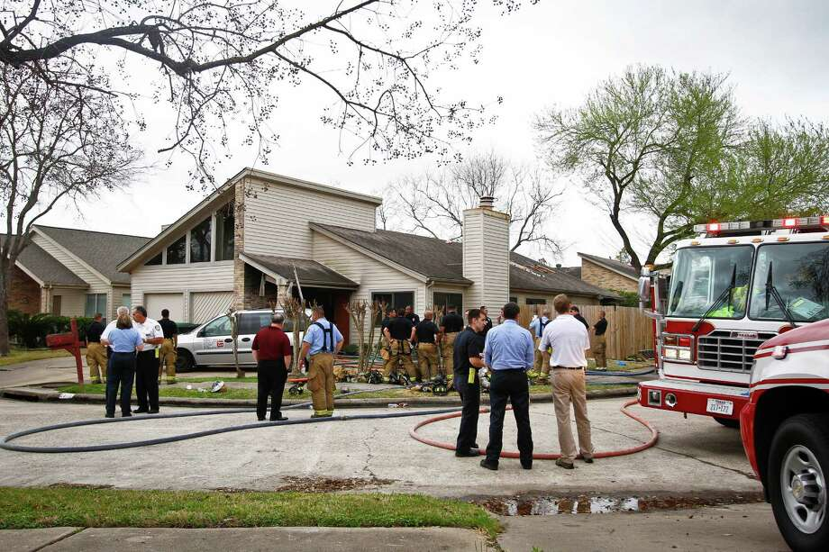 FILE - In this Feb. 24, 2011 file photo, emergency personnel respond to a fire at a home day care operated by Jessica Tata, killing four children in Houston. Attorneys for Jessica Tata, a Texas woman facing a murder charge after a fire at her home day care killed four children and injured three other kids, could begin presenting their case to jurors. However, Jessica Tata's attorneys declined to say how many witnesses, if any, they planned to call Tuesday, Nov. 6, 2012 to testify in a Houston courtroom. (AP Photo/Houston Chronicle, Michael Paulsen, File) Photo: Michael Paulsen, Associated Press / Houston Chronicle