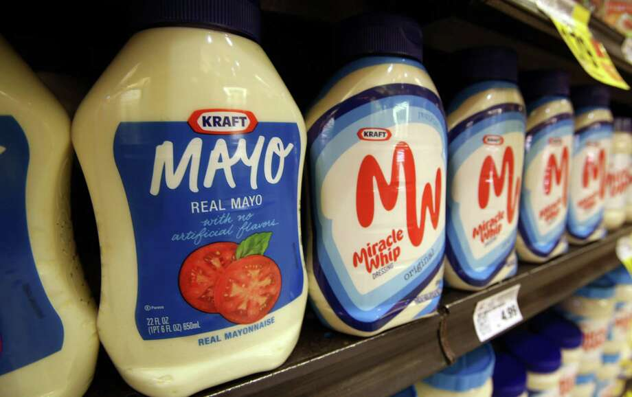 This Feb. 9, 2011, photo, shows containers of Kraft mayonnaise and Miracle Whip, at a Ralphs Fresh Fare supermarket in Los Angeles. Kraft Foods is embracing the spirit of a startup and betting that innovation will help it grow, as the maker of household names such as Oscar Mayer, Miracle Whip and Velveeta looks to redefine itself after splitting from its more glamorous global snack foods business. The company, which was established in 1903, said Wednesday, Nov. 7, 2012, that its net income rose 13 percent in the third quarter, as a mix of new products, increased advertising and productivity improvements lifted results. (AP Photo/Reed Saxon) Photo: Reed Saxon
