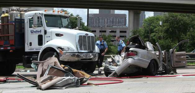 One person died on the scene of a traffic crash on U.S. 59 in downtown that prompted officials to temporarily shut down traffic heading northbound on the freeway this afternoon.   The four-vehicle pileup occurred about 1:10 p.m. by the entry ramp on the northbound Eastex Freeway at Interstate 45, near the George R. Brown Convention Center, police said. The identity of the deceased has not been released.Officials closed the northbound lanes while emergency crews and police clear the site on Friday, May 21, 2010, in Houston.  ( Mayra Beltran / Chronicle ) Photo: Mayra Beltran, Houston Chronicle / Houston Chronicle