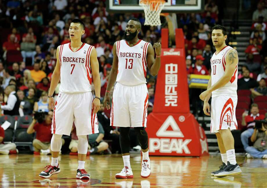 The Houston Rockets Jeremy Lin left, James Harden center and Carlos Delfino stand on the court as the Rockets play the Denver Nuggets during the second quarter of NBA game action at the Toyota Center Wednesday, Nov. 7, 2012, in Houston. Photo: James Nielsen, Chronicle / © Houston Chronicle 2012