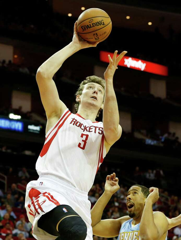 The Houston Rockets Omer Asik left, shoots the ball as the Denver Nuggets Andre Miller looks on during the second quarter of NBA game action at the Toyota Center Wednesday, Nov. 7, 2012, in Houston. Photo: James Nielsen, Chronicle / © Houston Chronicle 2012