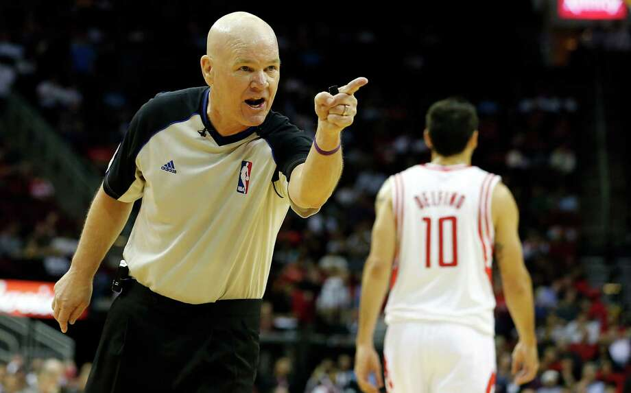 NBA Official Joe Crawford has stern words with The Houston Rockets Marcus Morris not shown, as the Rockets play Denver Nuggets during the second quarter of NBA game action at the Toyota Center Wednesday, Nov. 7, 2012, in Houston. The Rockets Morris had received a technical foul moments earlier in the game. Photo: James Nielsen, Chronicle / © Houston Chronicle 2012