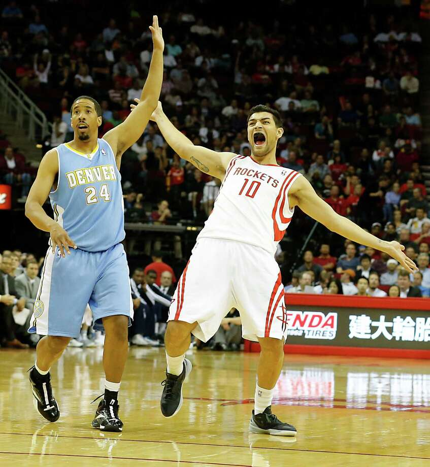 The Denver Nuggets Andre Miller left, and the Houston Rockets Carlos Delfino during the second quarter of NBA game action at the Toyota Center Wednesday, Nov. 7, 2012, in Houston. Photo: James Nielsen, Chronicle / © Houston Chronicle 2012