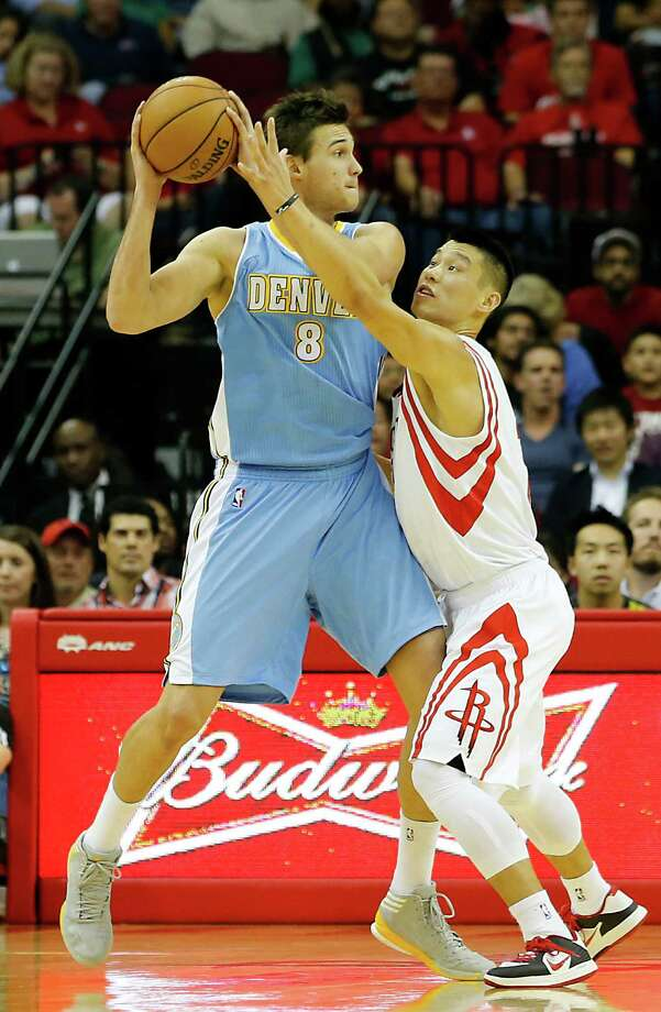 The Denver Nuggets Danilo Gallinari left, and the Houston Rockets Jeremy Lin during the first quarter of NBA game action at the Toyota Center Wednesday, Nov. 7, 2012, in Houston. Photo: James Nielsen, Chronicle / © Houston Chronicle 2012