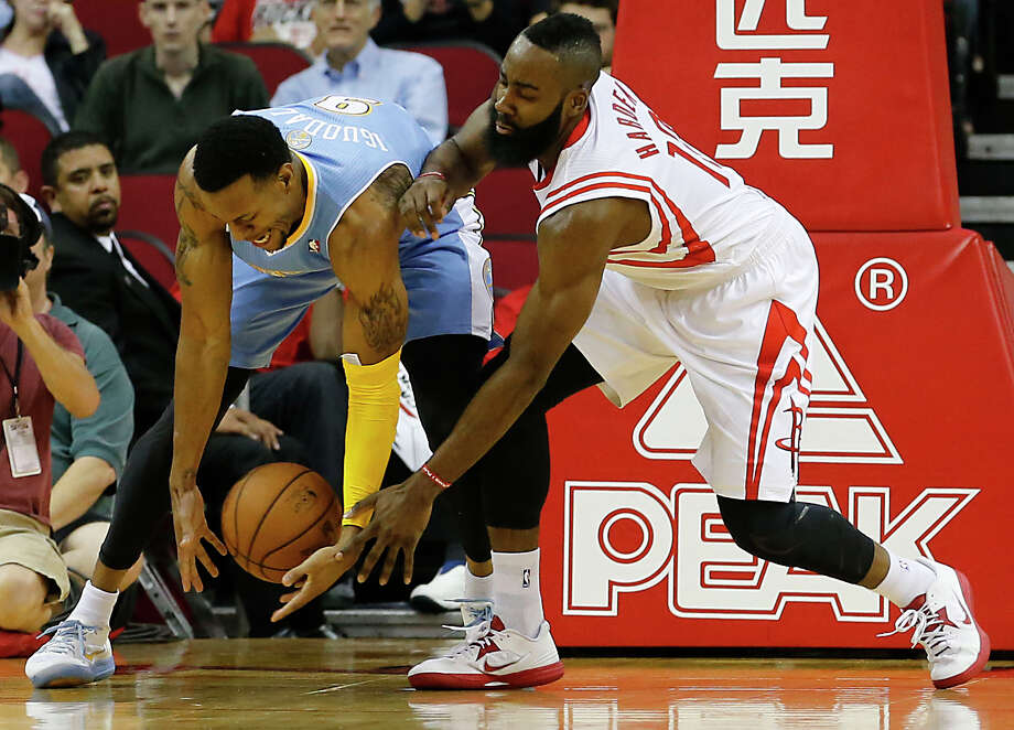 The Denver Nuggets Andre Iguodala left, and the Houston Rockets James Harden chase a loose ball during the first quarter of NBA game action at the Toyota Center Wednesday, Nov. 7, 2012, in Houston. Photo: James Nielsen, Chronicle / © Houston Chronicle 2012