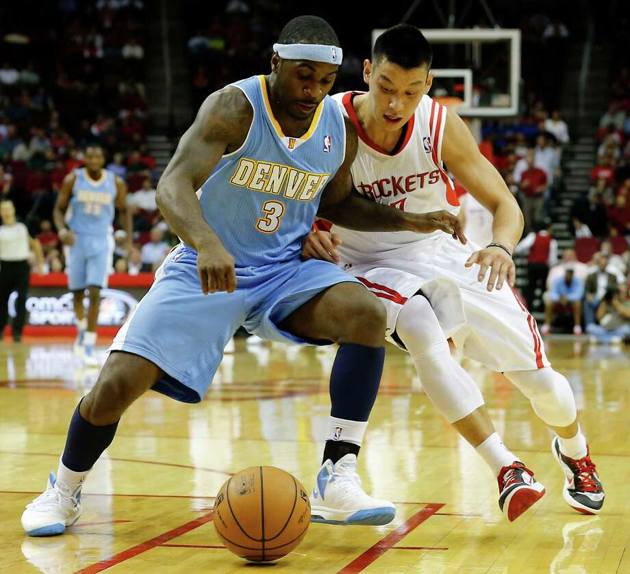 The Denver Nuggets Ty Lawson left, and the Houston Rockets Jeremy Lin chase a loose ball during the first quarter of NBA game action at the Toyota Center Wednesday, Nov. 7, 2012, in Houston. Photo: James Nielsen, Chronicle / © Houston Chronicle 2012