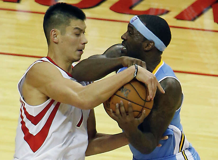 The Houston Rockets Jeremy Lin left, and the Denver Nuggets Ty Lawson wrestle for the ball during the fourth quarter of NBA game action at the Toyota Center Wednesday, Nov. 7, 2012, in Houston. Photo: James Nielsen, Chronicle / © Houston Chronicle 2012
