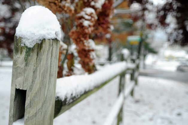 Snow piles on a wood fence in Stamford, Conn., on Thursday, November 8, 2012. Photo: Lindsay Niegelberg / Stamford Advocate