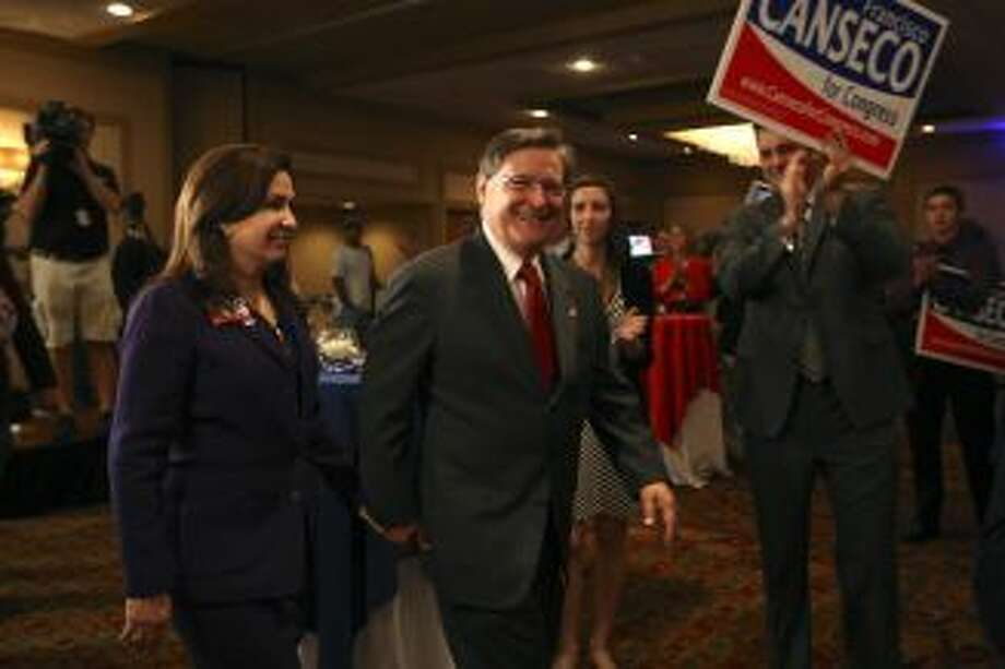 "U.S. Rep. Francisco ""Quico"" Canseco, R-San Antonio, and his wife, Gloria, arrive at a campaign rally. Canseco said it was too early to concede the race. Photo: Jerry Lara, Staff /  2012 San Antonio Express-News"