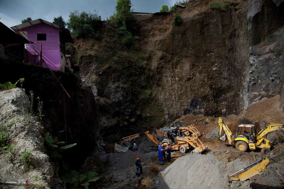 Residents and rescue workers use heavy equipment to look for people feared buried at a sand mine, after a magnitude 7.4 earthquake struck in San Marcos, Guatemala, Wednesday Nov. 7, 2012. The mountain village, some 80 miles (130 kilometers) from the epicenter, suffered much of the damage with some 30 homes collapsing in its center. There are three confirmed dead and many missing after the strongest earthquake to hit Guatemala since a deadly 1976 quake that killed 23,000. Photo: Moises Castillo, AP / AP