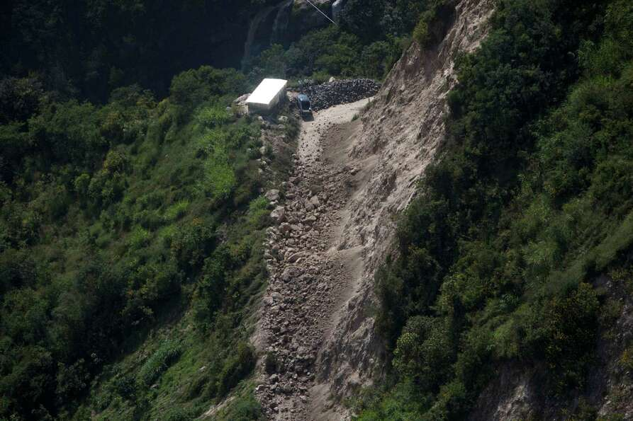 An overhead view of a road damaged when a magnitude 7.4 earthquake struck in San Marcos, Guatemala,