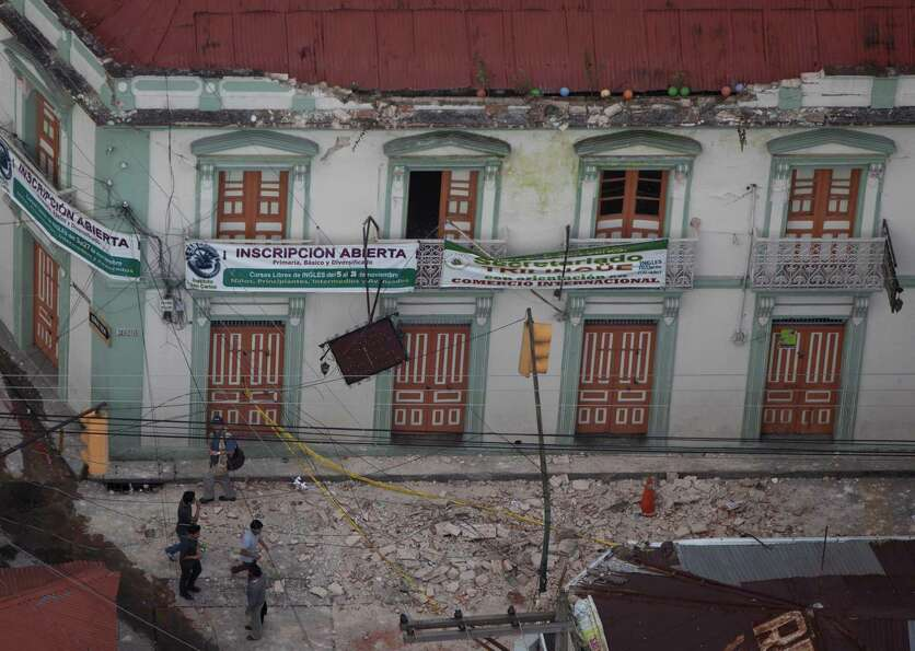 Rubble blankets a street after a magnitude 7.4 earthquake struck in San Marcos, Guatemala, Wednesday
