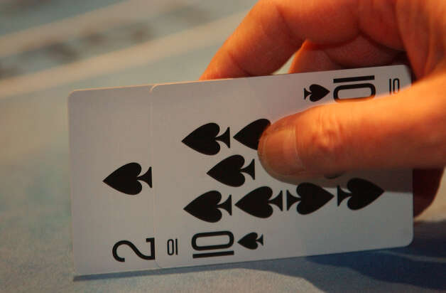Detail of a high stakes Black Jack hand  at Turning Stone Casino in Verona , New York December 2002 . (Michael  P. Farrell / Times Union Archive) Photo: MICHAEL P. FARRELL, DG / ALBANY TIMES UNION