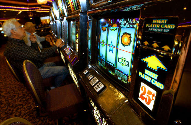 Slot machine players at Turning Stone Casino in Verona , New York . (Michael  P. Farrell / Times Union Archive) Photo: MICHAEL P. FARRELL, DG / TIMES UNION